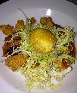 "A poached and fried ""crispy egg"" with bacon hushpuppies"