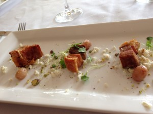 crispy pork belly with microgreens and feta,