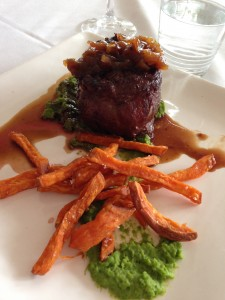 filet mignon with truffle pea puree and yam fries with a pile of caramelized onions,