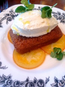 olive oil cake atop candied orange and topped with mascarpone whipped cream